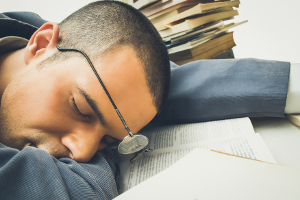 Young businessman sleeping on his desk