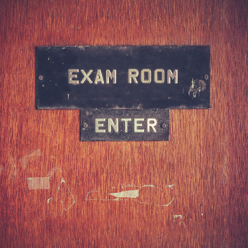 Retro Filtered Image Of A Grungy Exam Room Door At A Public School In The USA