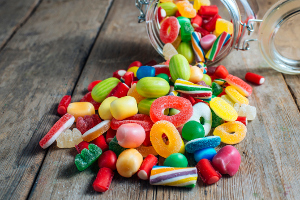 Colorful candy gum on old wooden table.