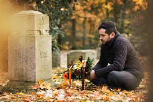 man at grave300