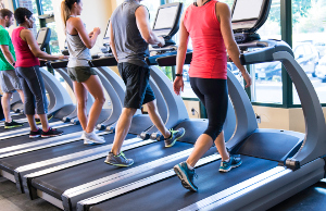 Runners on treadmills in a fitness facility